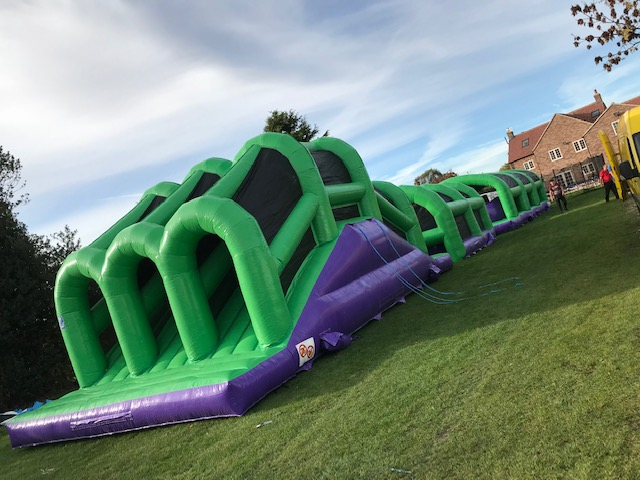110 foot inflatable obstacle course bouncy assault giant purple balls knockout total wipeout big red balls challenge