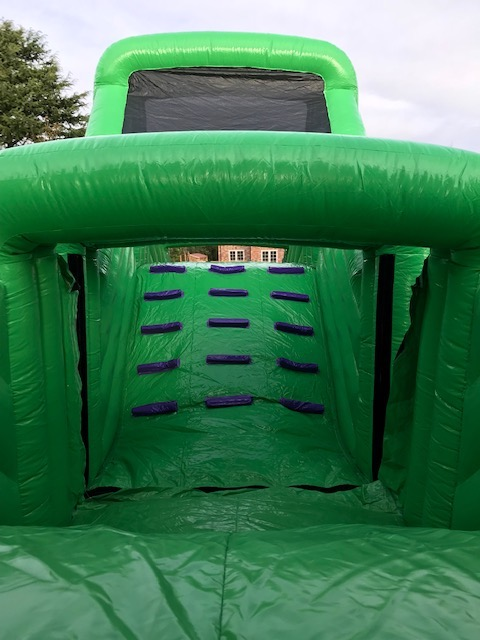 this is a photo of 90 foot inflatable assault obstacle course giant bouncy castle slide