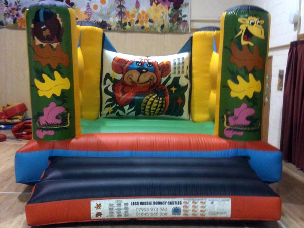 Jungle Themed Bouncy Castle 12ft  x 15ft x 9ft £65 Please quote castle number: 16