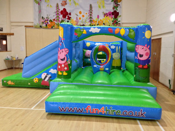 4 poster Pig themed combo bouncy castle with inflatable slide. 16ft x 19ft x 8ft£75. Please quote number: 70