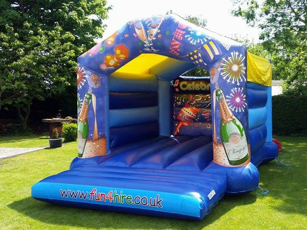 Adult and Kids Celebration Bouncy Castles 19ft x 14ft x 13ft (c)£80. Please quote number: 26