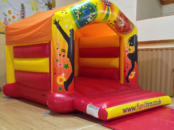 Disco Themed Bouncy Castle Children & Adults (C) 19ft x 14ft x 13ft£80 Please quote castle number: 49