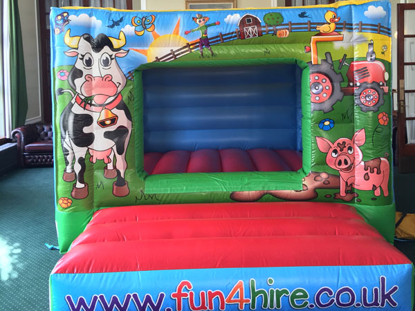 Farm yard fun bouncy castle,(c)  12ft x 15ft x 8 ft£65 or £70 with 1 bag of balls. Please quote number 14