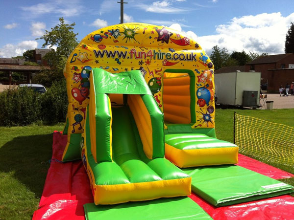 Fun4Hire Bounce House. Castle and slide combo. 20ft x 13ft x 9.5ft£75. Please quote number: 63