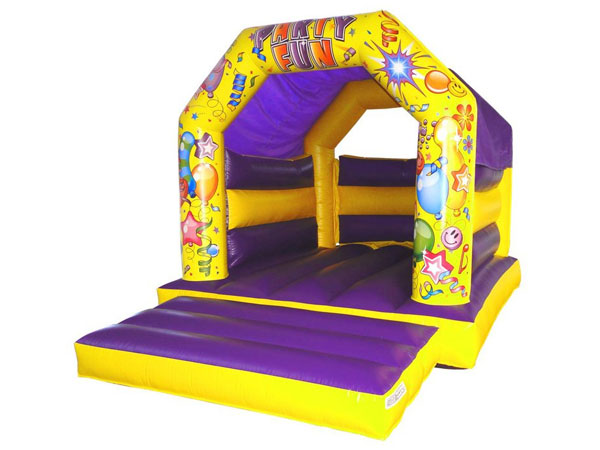Purple and Yellow Party Fun Bounce bouncy castle. 16ft x 11ft x 11ft£65. Please quote number: 75