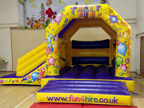 Purple and Yellow party fun combo castle and slide. 16ft x 19ft x 11ft£75. Please quote number: 59