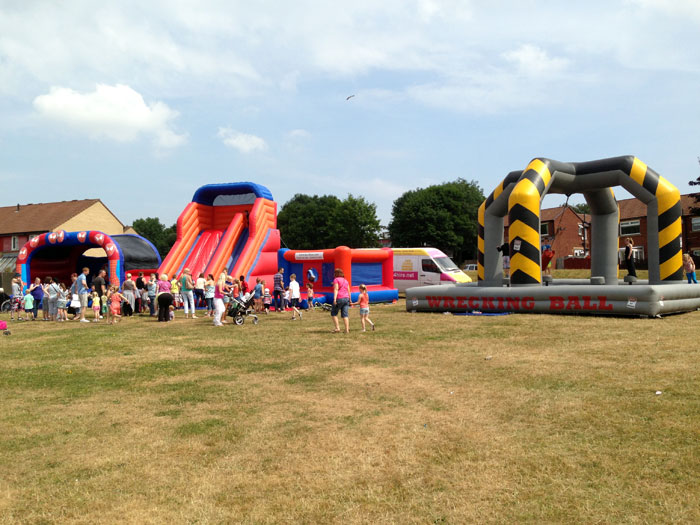 Inflatable wrecking ball game, slide and bouncy castles