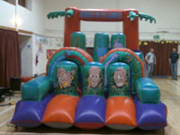 11ft x 25ft Rumble in the Jungle inflatable assault course �75