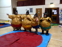 Sumo wrestling suits & 12ft x 12ft wrestling mat �60