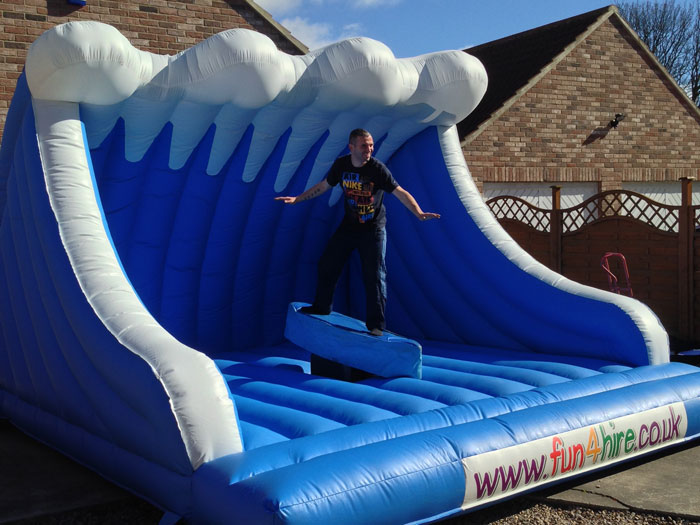 Deluxe ride on inflatable surf simulator